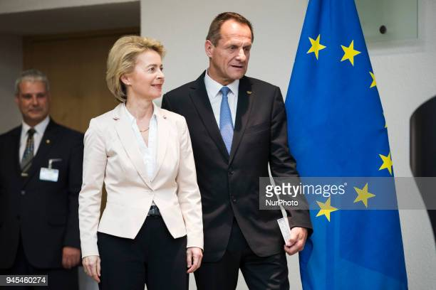 German Defence Minister Ursula von der Leyen and President of the German Olympic Sports Confederation Alfons Hoermann arrive to a ceremony to honour...