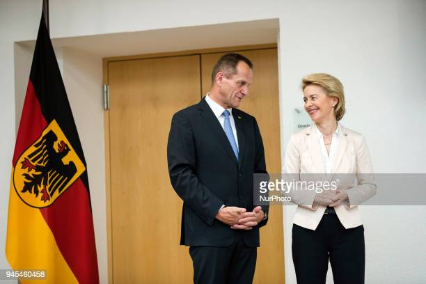 German Defence Minister Ursula von der Leyen and President of the German Olympic Sports Confederation Alfons Hoermann are pictured during a ceremony...