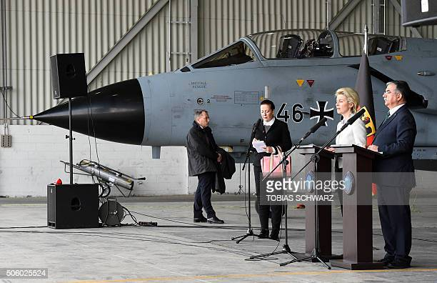 German Defence Minister Ursula von der Leyen and Turkish Defence Minister Ismet Yilmaz give a statement to the media next to a German Tornado jet...