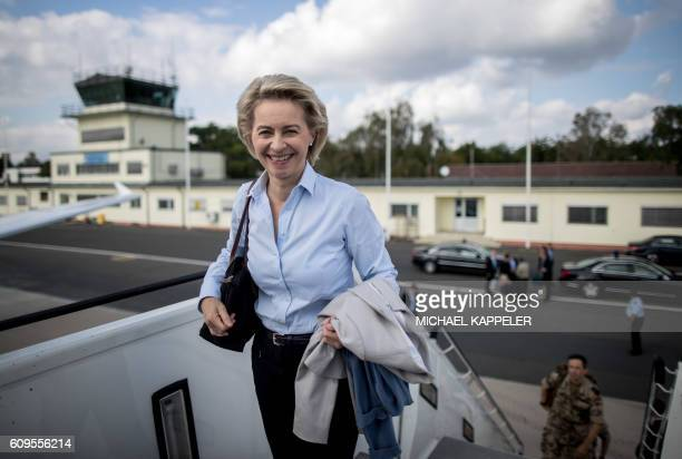 German Defence Minister Ursula von der Leyen boards an aircraft in Berlin to travel to Iraq for talks on September 21 2016 / AFP / POOL / Michael...