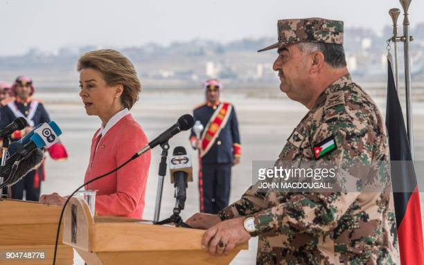 German Defence Minister Ursula von der Leyen delivers her speech as Jordanian Chairman of the Joints Chief of Staff Mahmoud Freihat looks on during a...