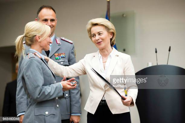 German Defence Minister Ursula von der Leyen gives a promotion to Aljona Savchenko during a ceremony to honour the members of the Bundeswehr who...