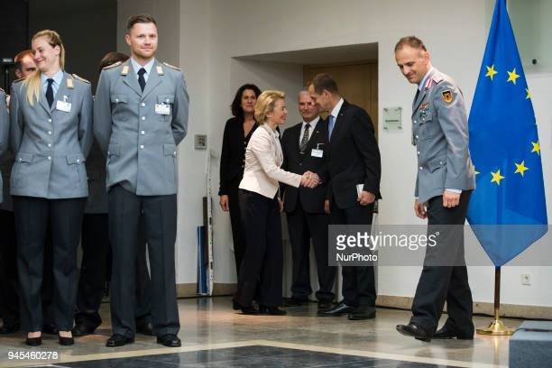 German Defence Minister Ursula von der Leyen greets the President of the German Olympic Sports Confederation Alfons Hoermann before a ceremony to...