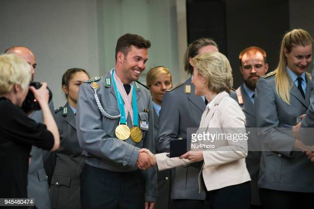 German Defence Minister Ursula von der Leyen hands over a medal to Tobias Wendl during a ceremony to honour the members of the Bundeswehr who...