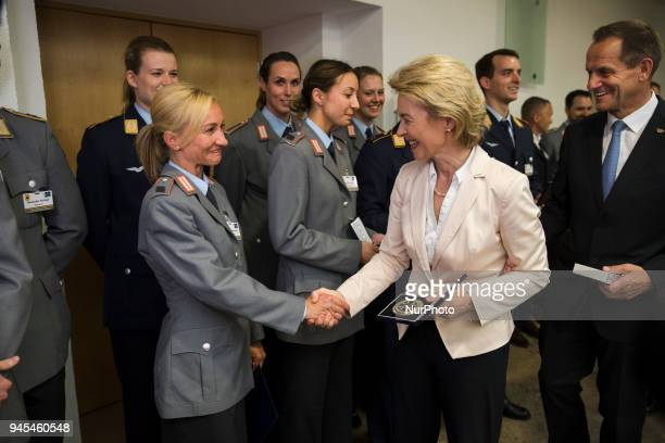 German Defence Minister Ursula von der Leyen hands over a medal to Aljona Savchenko during a ceremony to honour the members of the Bundeswehr who...
