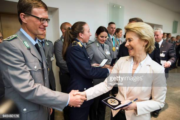 German Defence Minister Ursula von der Leyen hands over medals during a ceremony to honour the members of the Bundeswehr who attended the Winter...