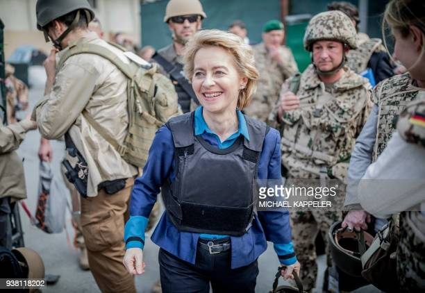 German Defence Minister Ursula von der Leyen heads to a helicopter to fly to the airport in Kabul on March 26 2018 / AFP PHOTO / POOL / Michael...