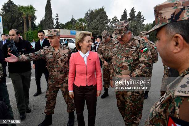 German Defence Minister Ursula von der Leyen is greeted by Jordanian Chairman of the Joints Chief of Staff Mahmoud Freihat prior to a handing over...