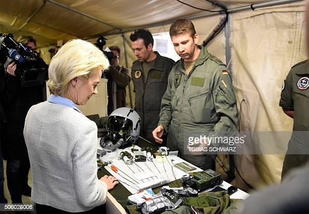 German Defence Minister Ursula von der Leyen looks at equipment of German Tornado jet pilots during a visit of the German Armed Forces Bundeswehr at...