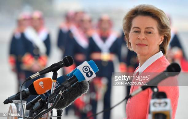 German Defence Minister Ursula von der Leyen looks on as Jordanian Chairman of the Joints Chief of Staff delivers his speech during a handing over...