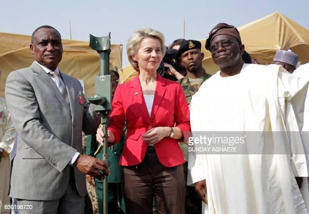 German Defence Minister Ursula Von Der Leyen poses with her Nigerian counterpart Brigadier-General Mansur Dan Ali and Nigerian Health Minister Isaac...
