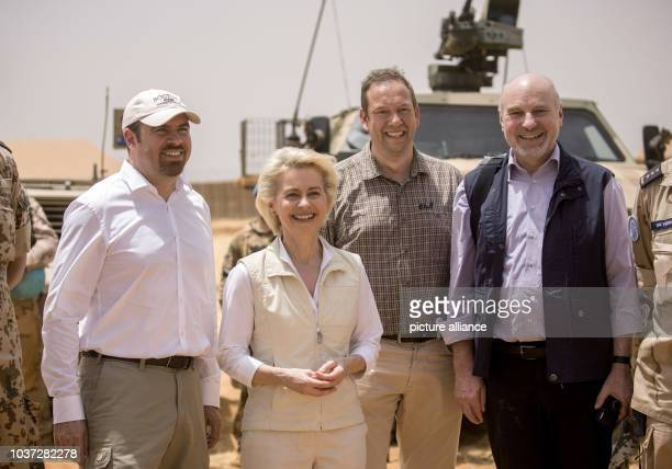 German defence minister Ursula von der Leyen poses with members of the German Bundestag parliamentary defence committee , Florian Hahn, Henning Otte...