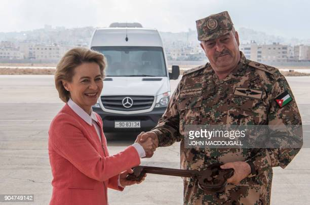 German Defence Minister Ursula von der Leyen shakes hands with Jordanian Chairman of the Joints Chief of Staff Mahmoud Freihat during a handing over...