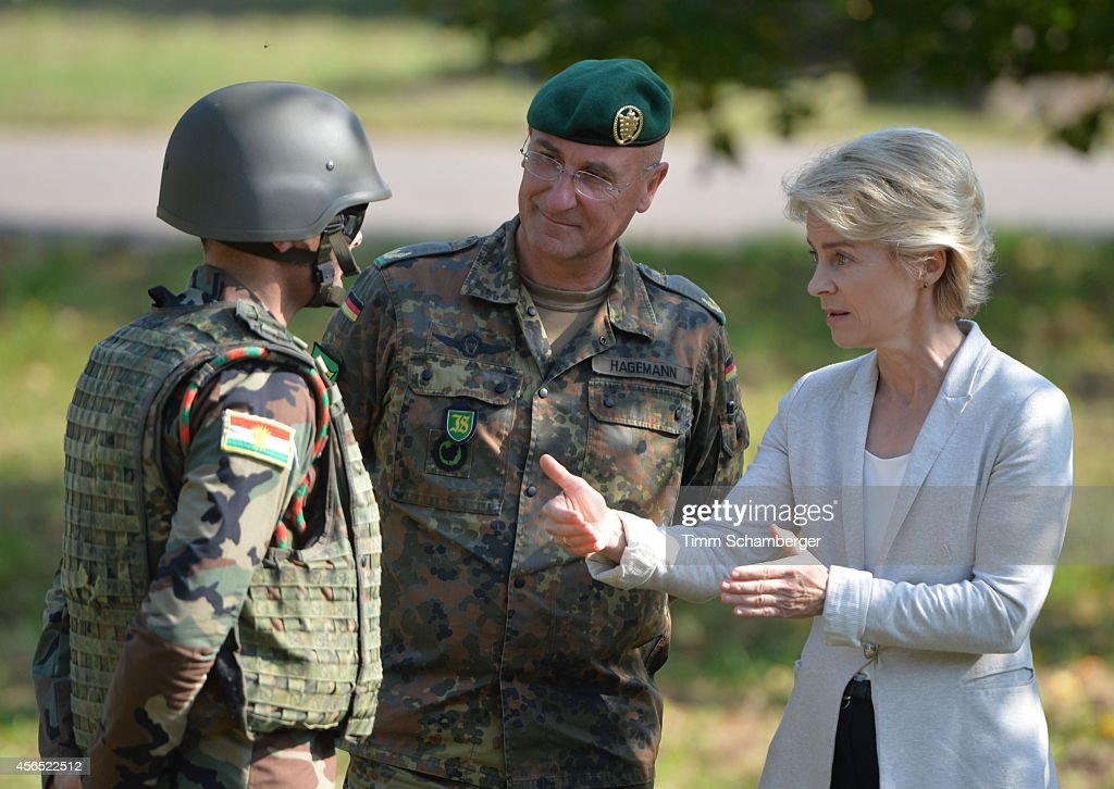 German Defence Minister Ursula von der Leyen (C) speaks to a peshmerga fighter next to German General Gert-Johannes Hagemann on October 02, 2014 in Hammelburg, Germany. A total of 32 peshmerga soldiers are at the base to train for one week in the use of the weapon before they return to northern Iraq. Germany has delivered to the peshmerga EUR 70 million worth of weaponry, including the Milan system, assault rifles, machine guns, pistols and other military hardware.