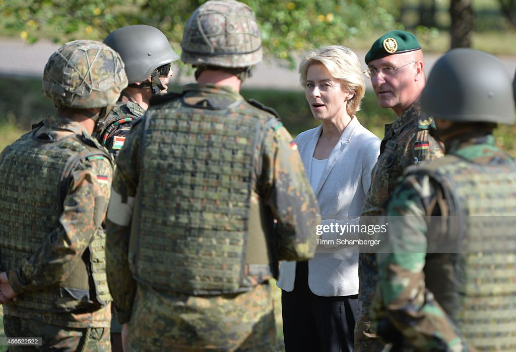 German Defence Minister Ursula von der Leyen (C) speaks to peshmerga fighters next to German General Gert-Johannes Hagemann on October 02, 2014 in Hammelburg, Germany. A total of 32 peshmerga soldiers are at the base to train for one week in the use of the weapon before they return to northern Iraq. Germany has delivered to the peshmerga EUR 70 million worth of weaponry, including the Milan system, assault rifles, machine guns, pistols and other military hardware.