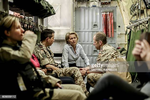 German Defence Minister Ursula von der Leyen speaks with officers onboard an aircraft to Iraq for talks on September 21 2016 / AFP / POOL / Michael...
