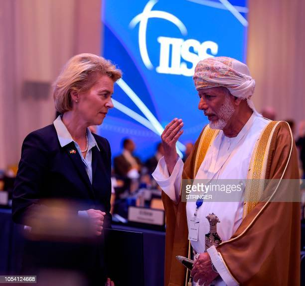 German Defence Minister Ursula von der Leyen speaks with Oman's minister responsible for foreign affairs Yusuf bin Alawi during the 14th...