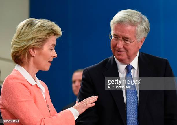 German Defence Minister Ursula von der Leyen talks with British Defence Secretary Michael Fallon during a Nato Defence Council meeting at the NATO...