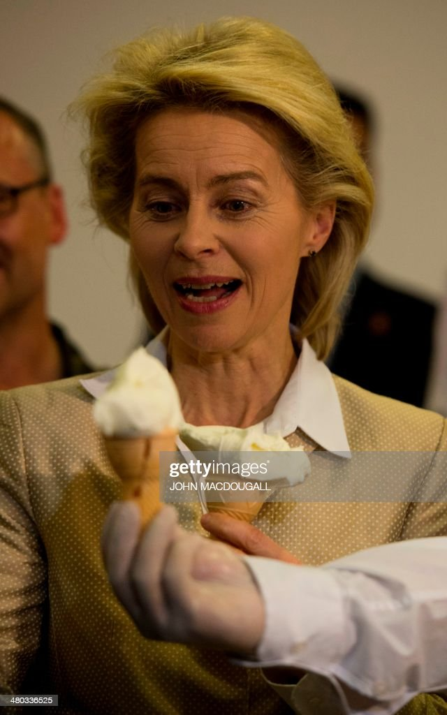 German Defence Minister Ursula von der Leyen tries a Turkish regional specialty, ice cream made with goat milk, during a reception in her honour at a hotel in Kahramanmaras, southern Turkey on March 24, 2014. Von der Leyen will visit German troops operating Patriot anti-missile defence installations, as part of a NATO-led initiative near the Turko-Syrian border.