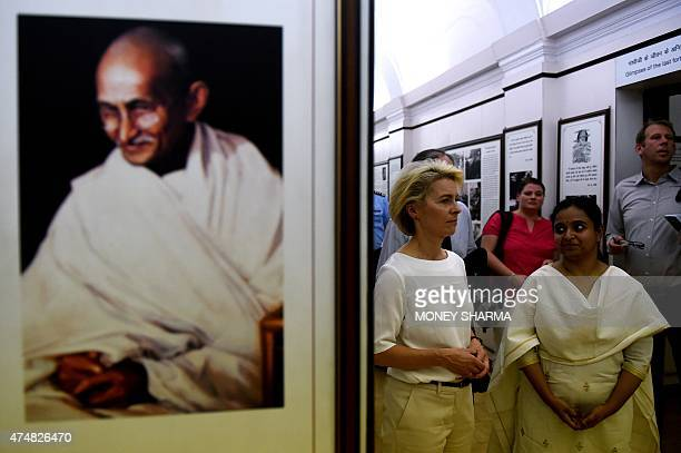 German Defence Minister Ursula von der Leyen walks with officials during her visit to Gandhi Smriti a museum dedicated to Mahatma Gandhi in New Delhi...