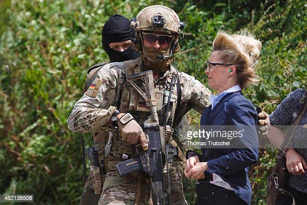 German Defence Minister Ursula von der Leyen wears protective glasses while a helicopter flies close to her during her visit of Special Forces...