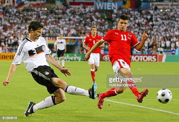 German defender Arne Friedrich vies with Austrian midfielder Umit Korkmaz during the Euro 2008 Championships Group B football match Austria vs....