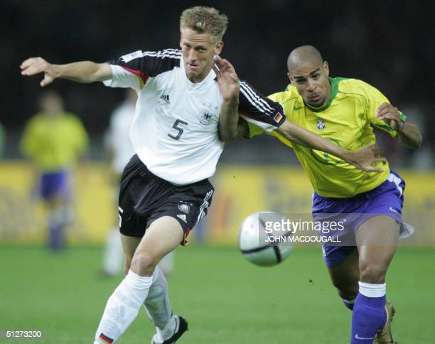 German defender Frank Fahrenhorst vies for the ball against Brazilian striker Adriano during their friendly football match of Germany against Brazil...