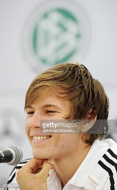 German defender Holger Badstuber addresses a press conference following a training session in Appiano near the north Italian city of Bolzano on May...