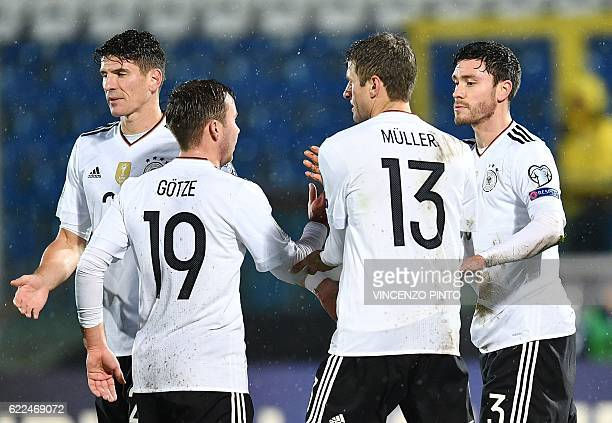 German defender Jonas Hector celebrates with teammates after scoring during the World Cup 2018 qualifying soccer match San Marino vs Germany at the...