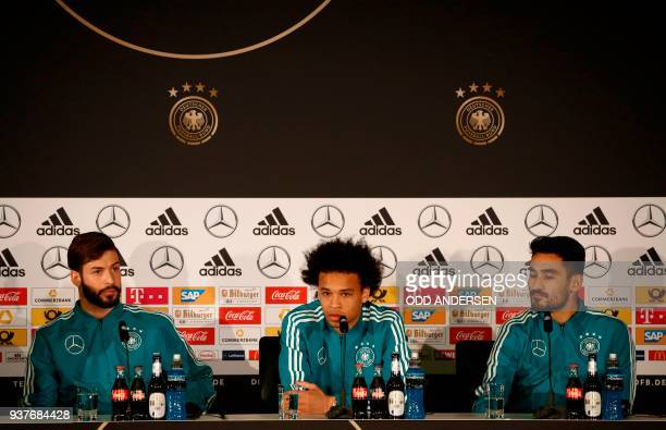 German defender Marvin Plattenhardt, German midfielder Leroy Sane and German midfielder Ilkay Gundogan address a press conference of the German...