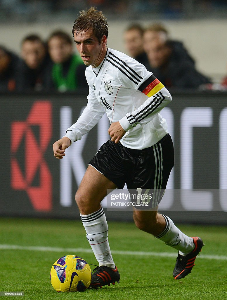 German defender Philipp Lahm controls the ball during the friendly football match Netherlands vs Germany on November 14, 2012 in Amsterdam.
