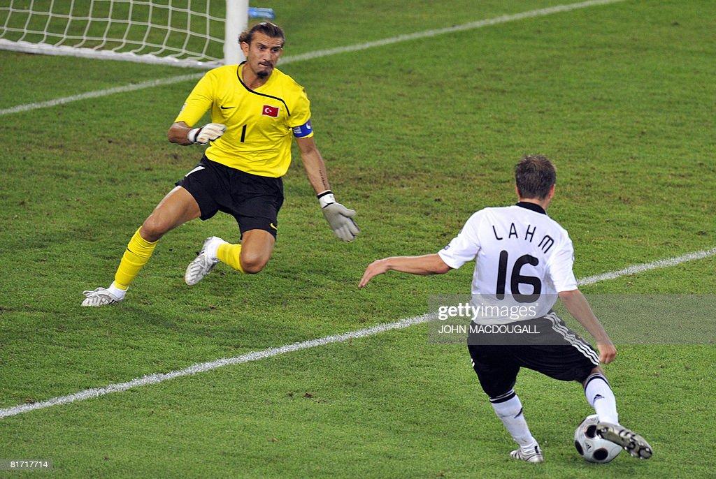 German defender Philipp Lahm (R) scores : News Photo