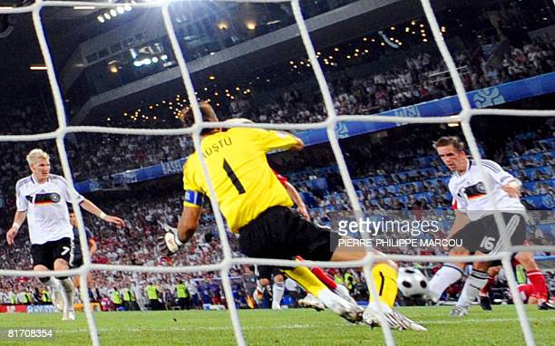 German defender Philipp Lahm scores in front of Turkish goalkeeper Rustu Recber during the Euro 2008 championships semifinal football match Germany...