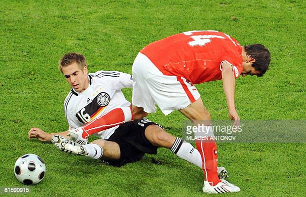 German defender Philipp Lahm vies with Austrian defender Gyorgy Garics during the Euro 2008 Championships Group B football match Austria vs. Germany...
