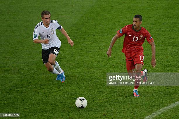 German defender Philipp Lahm vies with Portuguese midfielder Nani during the Euro 2012 championships football match Germany vs Portugal on June 9...