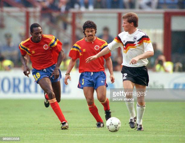 German defender Stefan Reuter playing the ball next to attacking Colombian opponents Freddy Rincon and Gilardo Gomez The match ends with a 11 tie in...