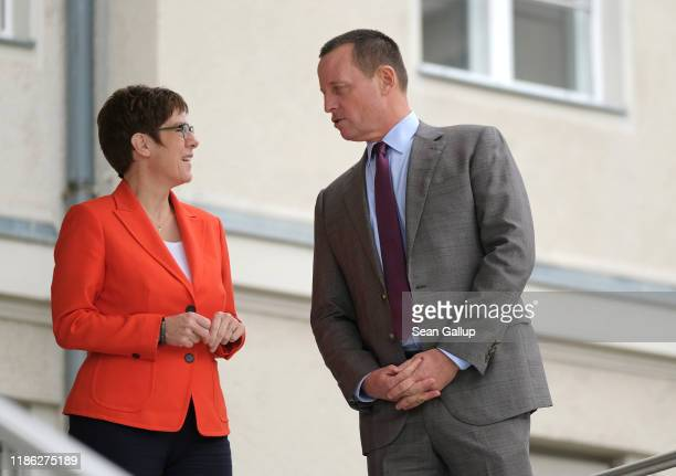 German Defense Minister Annegret KrampKarrenbauer chats with US Ambassador to Germany Richard Grenell as they wait to greet US Secretary of State...