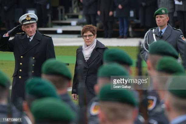 German Defense Minister Annegret KrampKarrenbauer inspects new recruits of the Bundeswehr the German armed forces before they took their oath of...