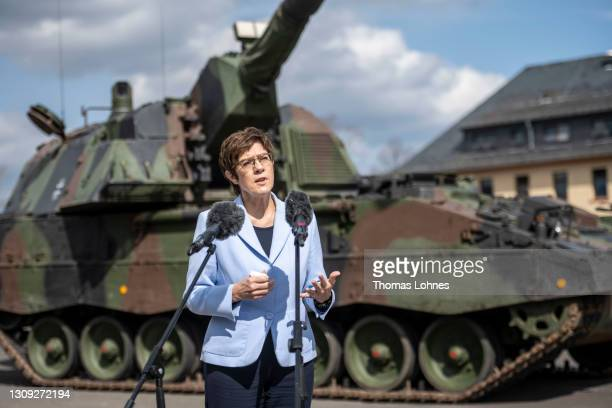 German Defense Minister Annegret Kramp-Karrenbauer speaks to the media in front of a Panzerhaubitze 2000 after she visits the Bundeswehr's training...