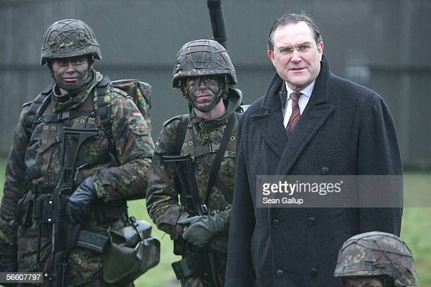 German Defense Minister Franz Josef Jung chats with soldiers while visiting the German Luftwaffe airbase at Wittmundhafen January 17 2006 at...
