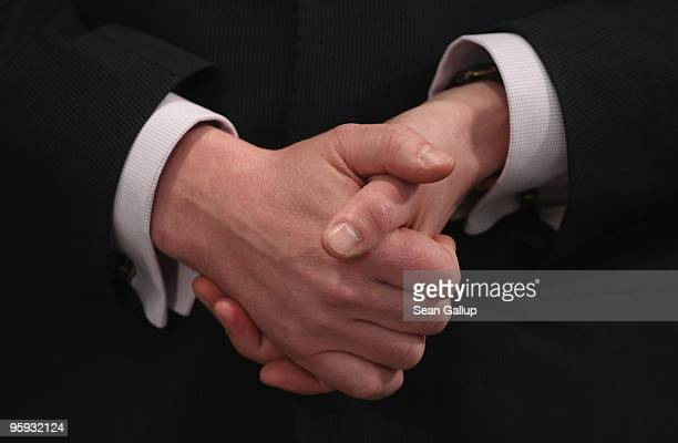 German Defense Minister KarlTheodor zu Guttenberg holds his hands together as he attends the inauguration ceremony of General Volker Wieker as new...