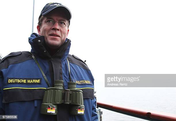 German Defense Minister KarlTheodor zu Guttenberg looks on during his inaugural visit aboard the FGS Mecklenburg Vorpommern Navy frigate on March 9...