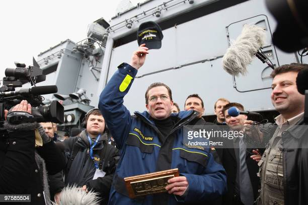 German Defense Minister KarlTheodor zu Guttenberg speaks to sailors of the German navy during his inaugural visit aboard the FGS Mecklenburg...