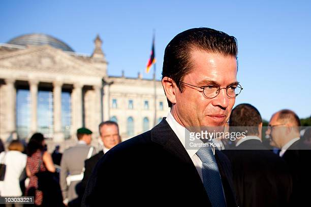 German Defense Minister KarlTheodor zu Guttenberg stands in front of the Reichstag after a swearingin ceremony for new recruits in front of the...