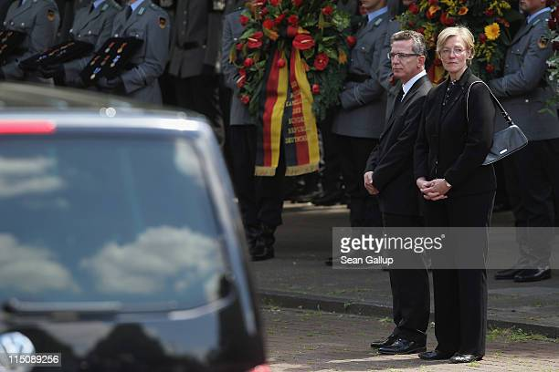German Defense Minister Thomas de Maiziere and his wife Martina de Maiziere depart after attending commemoration services for three Bundeswehr...