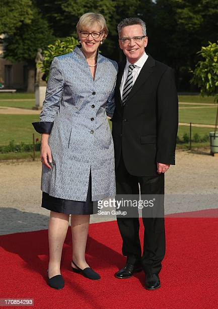 German Defense Minister Thomas de Maiziere and his wife Martina de Maiziere attend the dinner given in honour of US President Barack Obama at the...