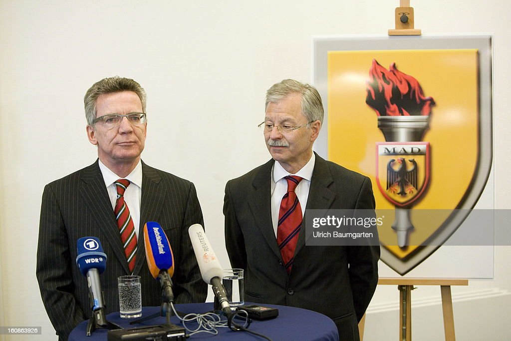 German Defense Minister Thomas de Maiziere (left), and Ulrich Birkenheier, President of the MAD, at the ministers visit the German Military Counter-Intelligence Service (MAD) on February 6, 2013 in Cologne, Germany. Defense Minister Thomas de Maiziere has rejected calls to shut down the Counter-Intelligence Agency despite fierce criticism from Ministers, following an investigation carried out by the Bundestag, for withholding information surrounding their recruitment of the NSU neo-Nazi terrorist Uwe Mundlos.