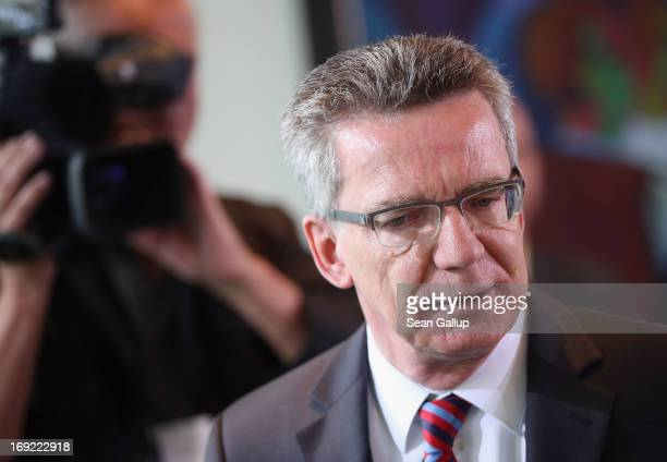 German Defense Minister Thomas de Maiziere arrives for the weekly German government cabinet meeting on May 22 2013 in Berlin Germany De Maiziere is...