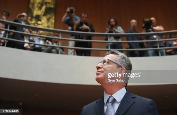 German Defense Minister Thomas de Maiziere arrives with commission chairwoman Susanne Kastner to testify at the Bundestag commission hearings over...