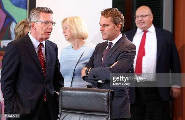 German Defense Minister Thomas de Maiziere German Education Minister Johanna Wanka German Health Minister Daniel Bahr and German Environment Minister...